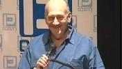 """אהוד אולמרט מרצה אתמול בכנס """"יוזמת ז'נבה"""" (צילום מסך: ערוץ 2)"""