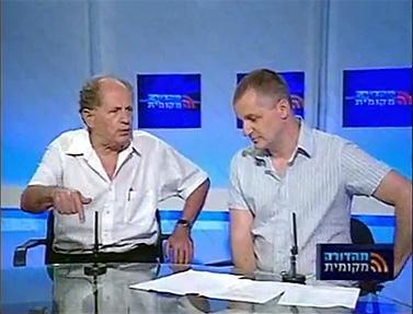 """אבישי מתיה (מימין) בעימות עם נציג העירייה בתוכנית """"מהדורה מקומית"""" (צילום מסך)"""