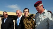 Released Israeli soldier Gilad Shalit walks with Israeli Prime Minister Benjamin Netanyahu, Defense Minister Ehud Barak, and Israeli Chief of Staff Lt. Gen. Benny Gantz, at the Tel Nof Air base in southern Israel, Tuesday, Oct. 18, 2011. Photo by Ariel Hermoni, Defense Ministry