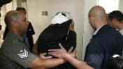אחד החשודים בהתעללות בילדים, אתמול בבית משפט השלום בירושלים (צילום: פלאש 90)