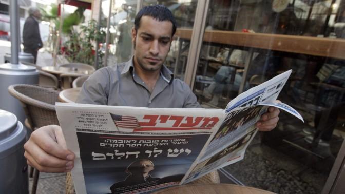 """תמו הימים? אדם מעיין ב""""מעריב"""" בבית-קפה בירושלים, 5.11.2008 (צילום: אורי לנץ)"""