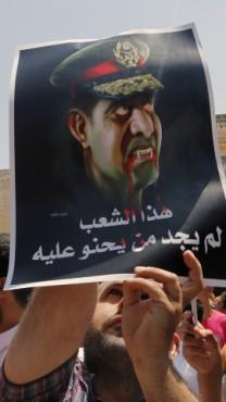 כרזת תמיכה באחים-המוסלמים שהונפה בהפגנה בירושלים. 16.8.13 (צילום: סלימאן חאדר)