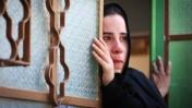 פלסטינית צופה בהלווייתו של סעד דוואבשה, 8.8.15 (צילום: פלאש 90)