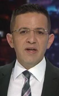 """אמיר איבגי מגיש את """"המוסף"""" בערוץ 1 (צילום מסך)"""