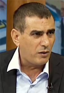 """ד""""ר נאצר אל-לחאם, העורך הראשי של סוכנות הידיעות הפלסטינית מען (צילום מסך)"""