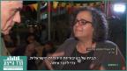 """עאידה תומא-סלימאן ואורי לוי, בכתבה של """"חדשות השבוע"""" (צילום מסך)"""