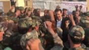 חיילים מריעים לרודן הסורי בשאר אל אסד; אידליב, 2019 (צילום מסך)