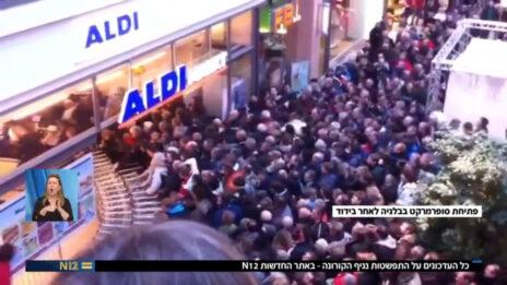 """""""פתיחת סופרמרקט בבלגיה לאחר בידוד"""". מתוך """"אולפן שישי"""", 13.3.2020 (צילום מסך)"""