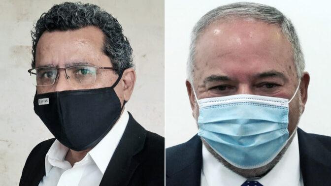 אביגדור ליברמן ויואב יצחק, בית המשפט המחוזי, 24.11 (צילומים: אורן פרסיקו)